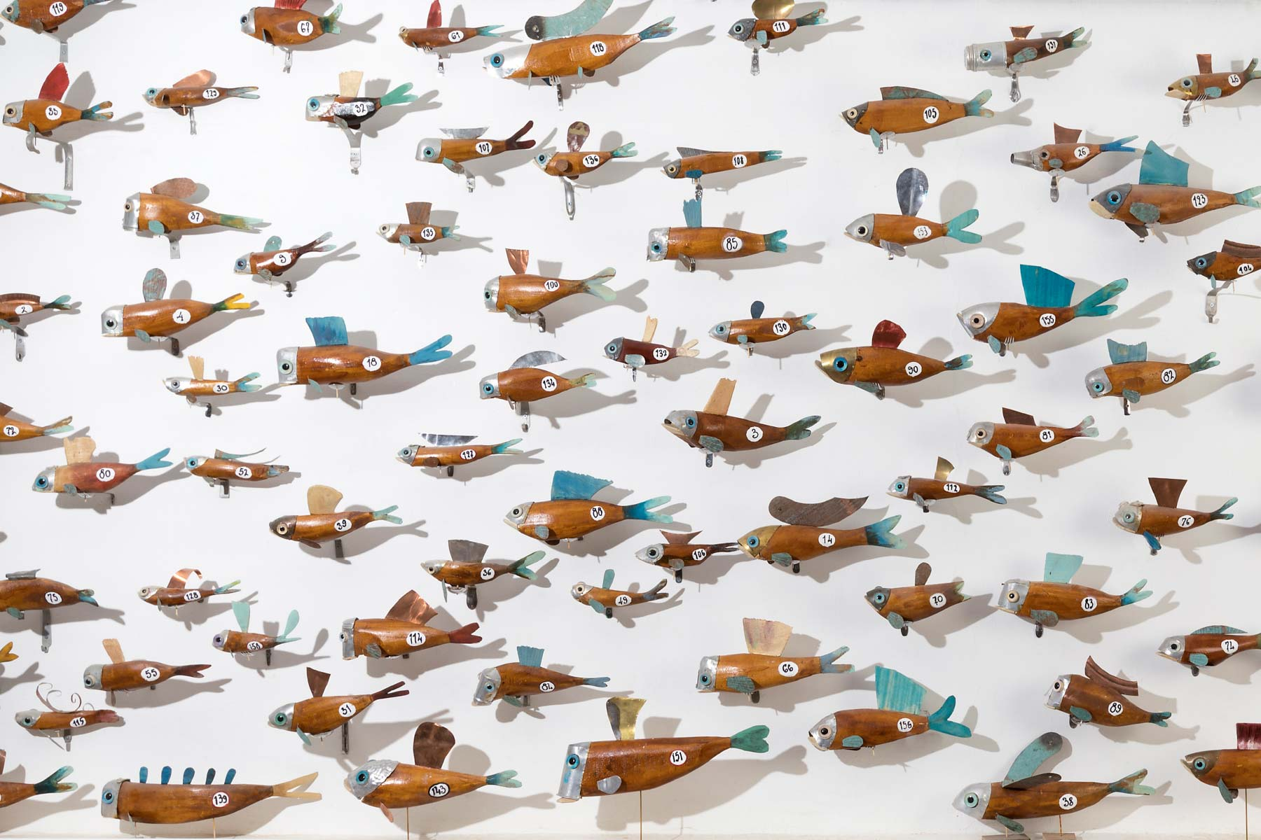 Stefano Prina Wall of Fishes Installation of 170 wooden fish italiano plurale